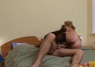 Massive ass MILF riding her son's thick dick on a bed