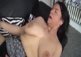 Busty brunette sucking her son's semi