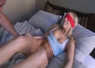 Blindfolded blonde enjoys brother's touch