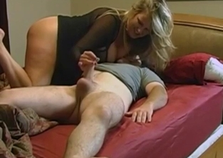 Busty mommy helps her little boy cum hard