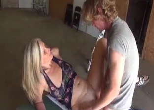 Blonde mommy jerking her sons' dicks outdoors
