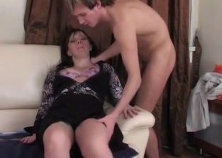 Dark-haired MILF fucking her horny son