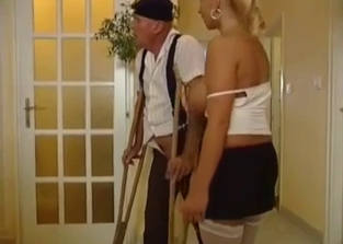 Blonde jerking her crutches-wielding dad's cock