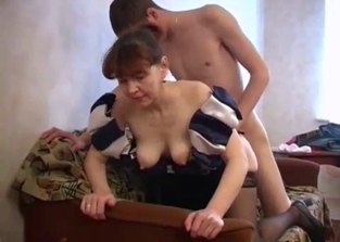 Dress-wearing mommy with saggy tits fucks her son