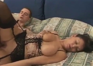 Stockings-clad mommy sideways fucked by her son