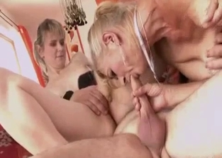 Mommy and daughter pleasuring the dad's dick