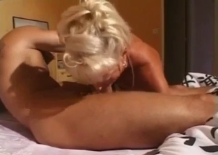 Tanned MILF seduces her big-dicked sleeping boy