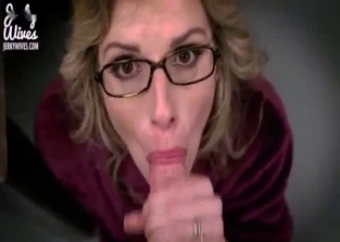Spectacled mommy gives a spectacular handjob